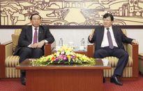 Bộ trưởng Trịnh Đình Dũng tiếp Bộ trưởng Bộ Công chính và Vận tải Lào, Ts. Bounchanh SINTHAVONG