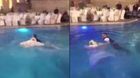 Diện váy cưới nhảy xuống bể bơi, cô dâu suýt chết đuối