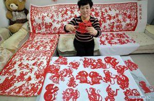 Chú khỉ trong nghệ thuật cắt giấy Trung Quốc