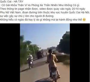 Cô gái khỏa thân đi xe máy giữa đường phố Hà Nội