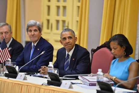 Tuong thuat ngay lam viec dau tien cua Obama tai Ha Noi - Anh 17