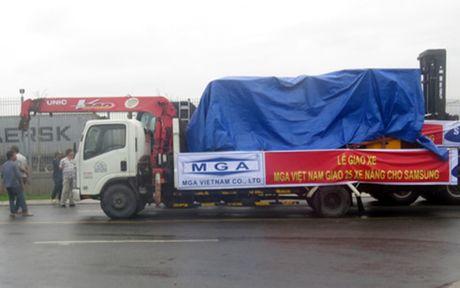 MGA ban giao 25 xe nang cho SAMSUNG - Anh 1
