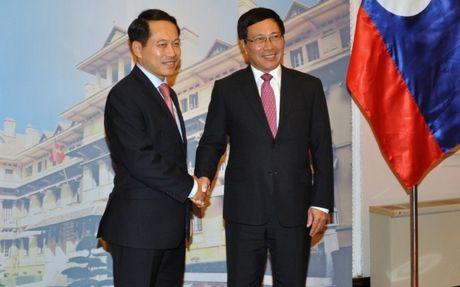 Viet - Lao cam ket duy tri quan diem chung ASEAN ve Bien Dong - Anh 1