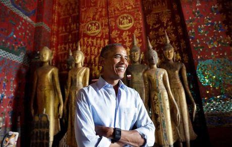 Ong Obama uong nuoc dua, tham chua chien o Lao - Anh 1