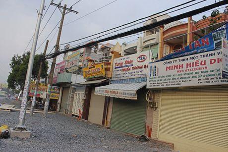"""DN tam dung kinh doanh do """"bao bui"""" tren duong Kinh Duong Vuong - Anh 3"""