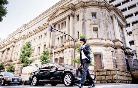Dang sau cac dong thai lai suat cua Fed va BoJ - Anh 1