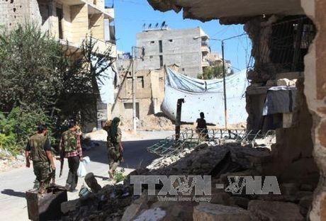 Quan doi Syria danh chiem khu vuc quan trong o Aleppo - Anh 1