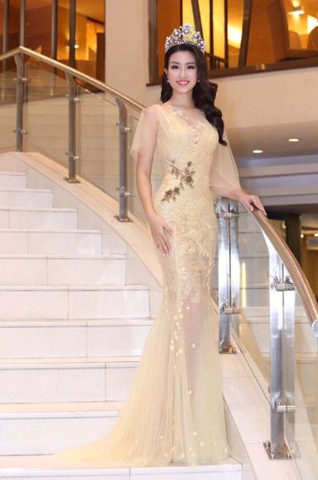 Hoa hau Do My Linh cat toc ngan, khoe nhan sac rang ro - Anh 5
