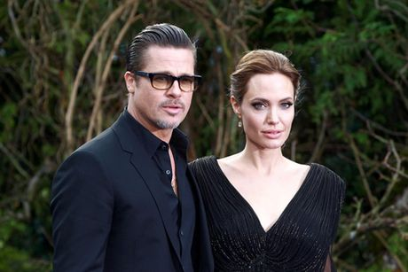 Angelina Jolie va Brad Pitt dat thoa thuan tam thoi ve con cai - Anh 1