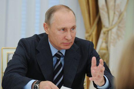 Putin dinh chi thoa thuan hat nhan voi My - Anh 1