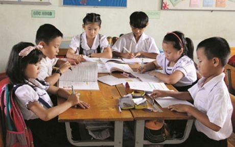 Xu ly mot truong hop day them khong phep cap tieu hoc - Anh 1