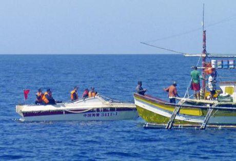 Philippines bat ngo nhuong bo Scarborough voi Trung Quoc? - Anh 1