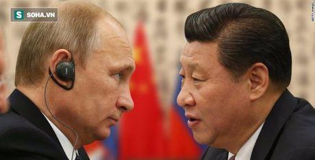 Bao Phap: Tap Can Binh dung 'ke' cua Putin de bam tru quyen luc - Anh 1