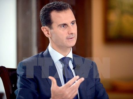 Tong thong Syria al-Assad canh bao nguy co xung dot toan cau - Anh 1