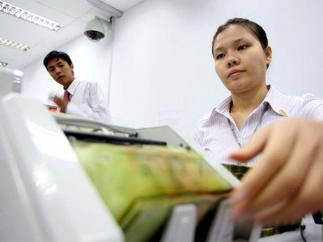 Vietcombank giam lai suat cho vay - Anh 1
