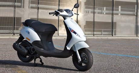 Honda Vision va Piaggio Zip nen mua xe nao la tot nhat? - Anh 3