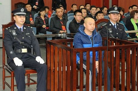 Trung Quoc: Gay oan sai, Pho giam doc cong an linh an 18 nam - Anh 1